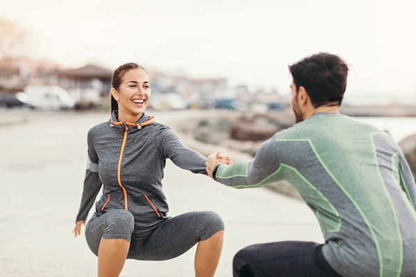Exercising together outdoors in early morning