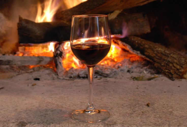 Fireplace and glass of wine